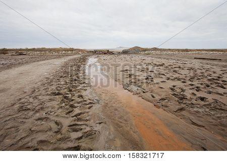 Creek with therapeutic mud near saline (salt lake) Baskunchak. Astrakhan region.