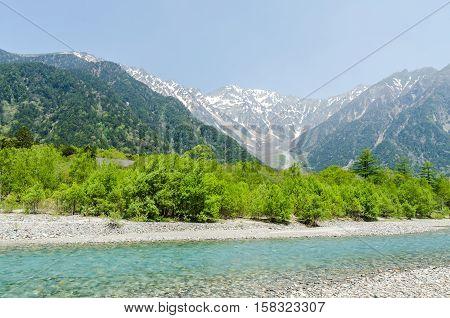 Hotaka mountain range and azusa river in spring at kamikochi national park nagano japan