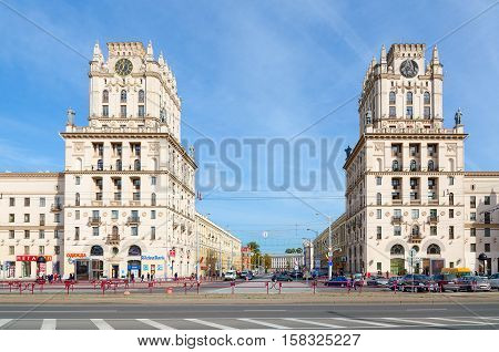 MINSK BELARUS - OCTOBER 1 2016: Unidentified people go on Privokzalnaya square. Architectural complex in style of Stalin's empire consists of two 11-storey buildings-towers known as