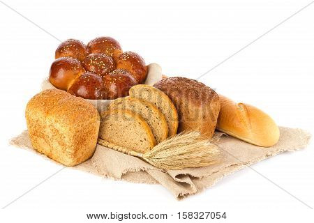 Still life of fresh baked goods and ear Isolated on white background