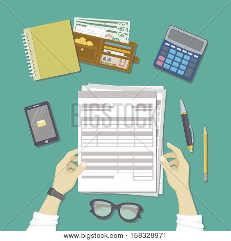 Man working with documents. Human hands hold the accounts, payroll, tax form. Workplace with papers, blanks, forms, phone with message, smart watches, wallet with money, credit cards. Top view Vector
