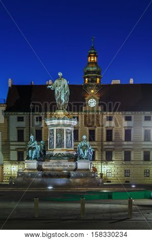 Monument To Emperor Franz 1 in front of Amalienburg in Hofburg Palace Vienna Austria. Evening