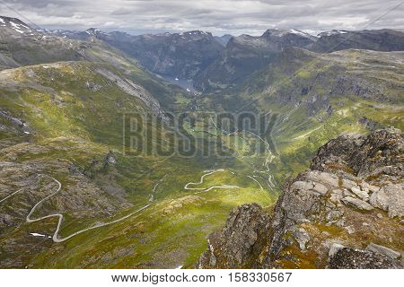 Norwegian rocky mountain landscape with secondary road. Norway highlight. Horizontal