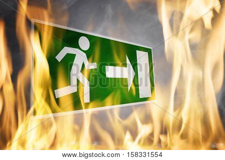 Close-up Of Emergency Fire Exit Board Burning In The Fire Flame