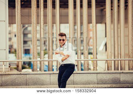 happy handsome man exults. promotion at work