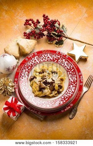 christmas italian ravioli with cheese flake and cep mushroom