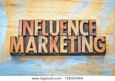 influence marketing - word abstract in vintage letterpress wood type printing blocks