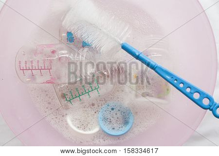 baby bottles it was clear that a disinfectant in water cleaning solution with bottle brush and hand holding clean