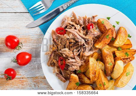 Portion Of Pulled Slow-cooked Delicious Meat With Fried Potato