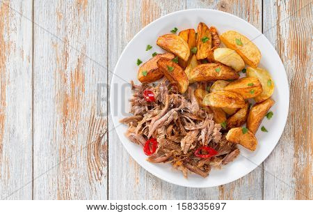 Pulled Slow-cooked Meat Roasted In Oven With Fried Potato