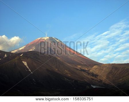 Kamchatka peninsula, the landscape. Early morning and the blue sky, the volcano. Kamchatka, Russia
