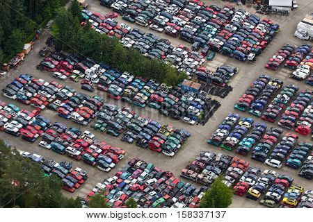 several cars destroyed in the courtyard of the automobile junkyard