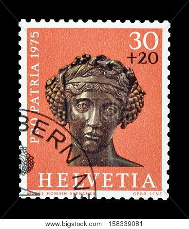 SWITZERLAND - CIRCA 1975 : Cancelled postage stamp printed by Switzerland, that shows Head of a bronze statue of Bacchus.