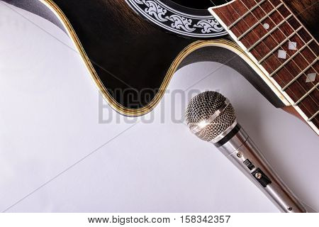 Acoustic Guitar And Microphone Isolated On White Table Top View
