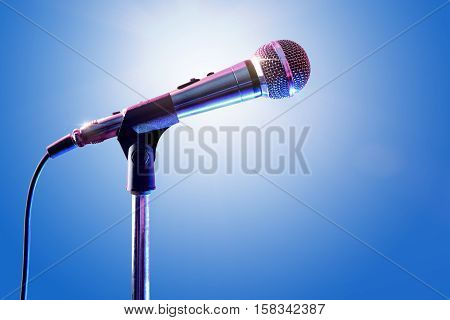 Microphone On Microphone Stand With Blue Background
