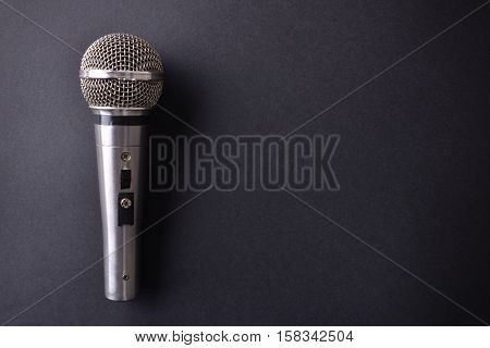 Silver Metal Microphone On Black Table Top View