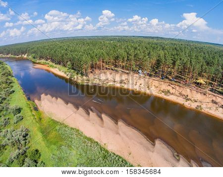 The view from the height of the river Mologa and forest along the sandy shore. Shooting from height of the bird's flight. Maksatikhinsky District Tver Region.
