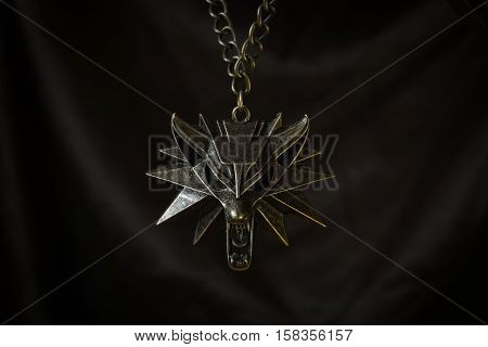 Fantasy locket with wolf's head and with chain