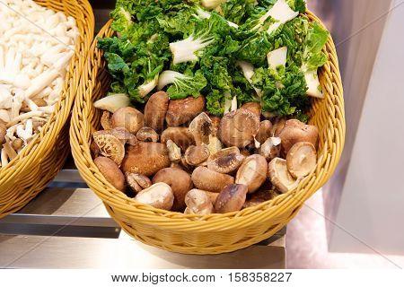 Various Mushroom types and vegetable in a basket