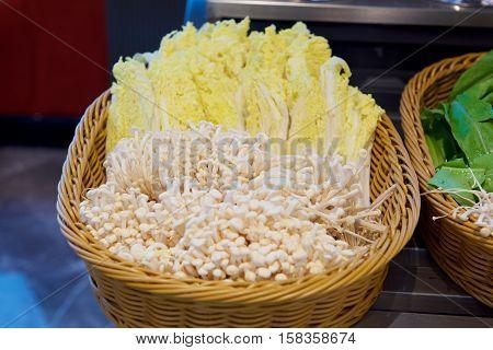 Enoki mushrooms and vegetable in the basket