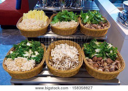 Various Mushroom types and vegetable in baskets