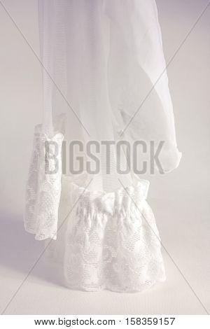 white stockings on white background, fishnet elastic band, bride