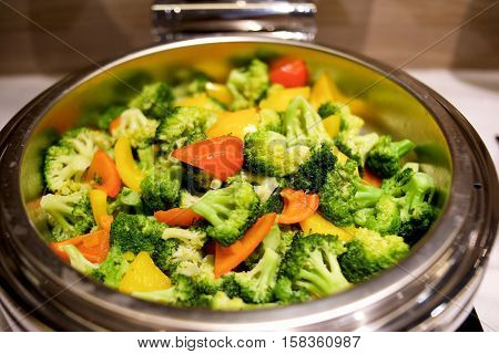 Broccoli with bell peppers dish in buffet restaurant