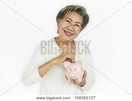 Senior Adult Hold Piggy Bank Concept