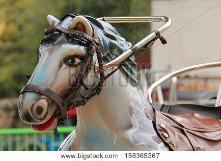 The Horse Seat of a Childrens Fun Fair Ride.