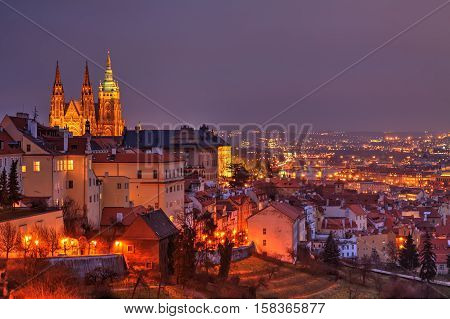 Night Prague view with gothic Castle and ols town, Czech Republic