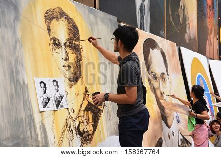 BANGKOK THAILAND - November 122016 : Thai art students paint portraits of Thai King Bhumibol Adulyadej at Silpakorn University in Bangkok. King Bhumibol the world's longest reigning monarch