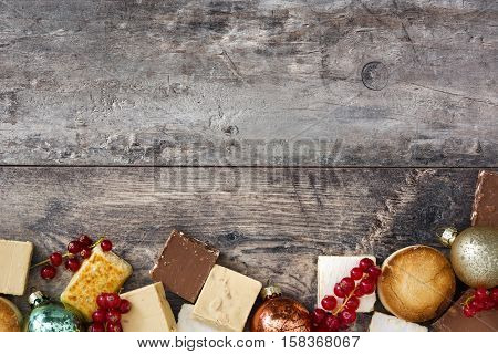 Christmas nougat and spanish polvorones on wooden background.Copyspace