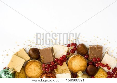 Christmas nougat and spanish polvores isolated on white background. Copyspace