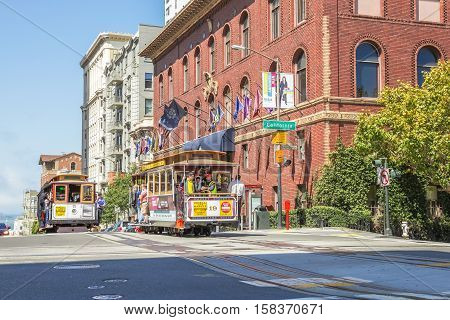 San Francisco, California, United States - August 17, 2016: two Cable Car ride for California and Powell streets, where the three lines intersect in a set double crossovers in Nob Hill.
