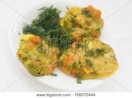 Healthy baked vegan vegetable pakoras on plate