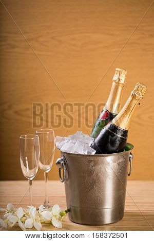 Champagne bottles in an ice bucket and champagne flutes
