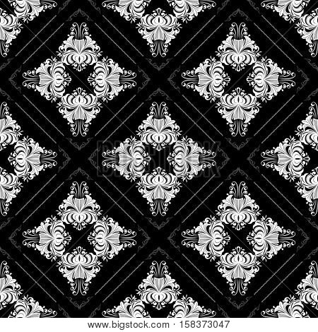 Seamless black and white ornate vintage wallpaper pattern with flowers.