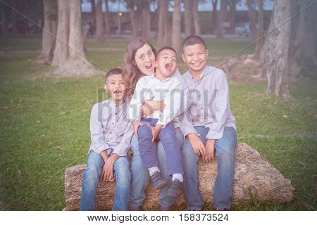 Mother and sons in an inter- racial adoption