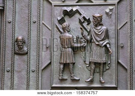Prague, Czechia - November, 21, 2016: fragment of a door repousse of St. Vitus Cathedral in Prague Castle, Czechia