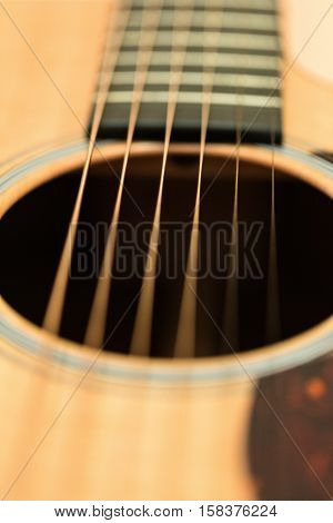 The Strings and Sound Hole of a Guitar - Close Up