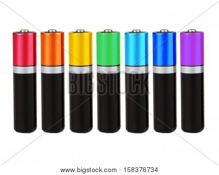 Seven batteries of the type AA in a row, seven colors of the rainbow (spectrum), on a white background, isolated