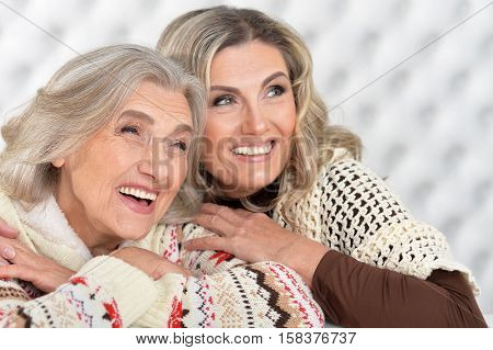 Portrait of happy senior woman with daugther hug