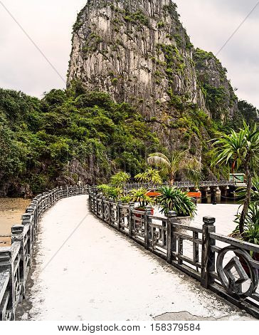 Halong Bay island wharf - path leading towards island limestone mountain
