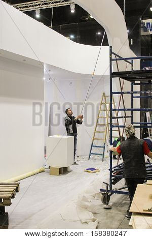 St. Petersburg, Russia - 2 October, Painting drywall constructions, 2 October, 2016. Construction and preparation work for the St. Petersburg Gas Forum.