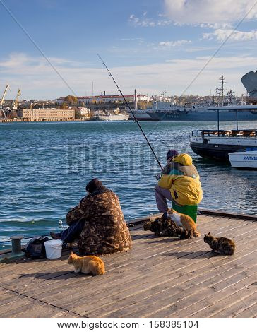 Sevastopol, Russia - November 14, 2015: Fishermen on fishing from a pier Grafskoy landing stage in Sevastopol Crimea