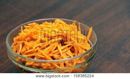 Korean-style Spicy Carrot Saladin Glass Bowl on Wooden Table
