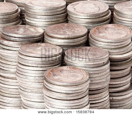 Many stacks of old silver dimes face on to camera poster