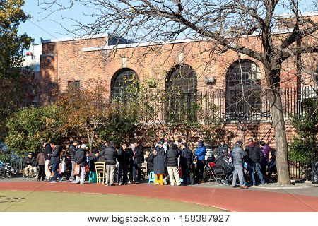 New York, United States of America - November 17, 2016: Chinese people gahering in public park in Chinatown to play games