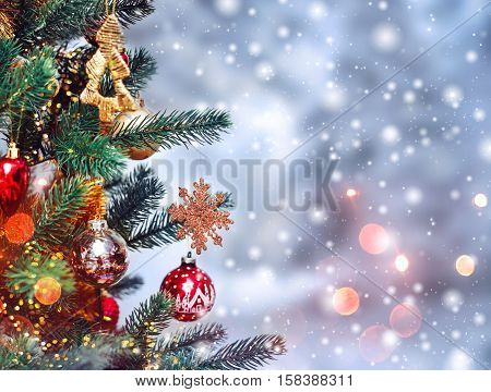 Christmas tree background and Christmas decorations with snow blurred sparking glowing. Happy New Year and Xmas theme
