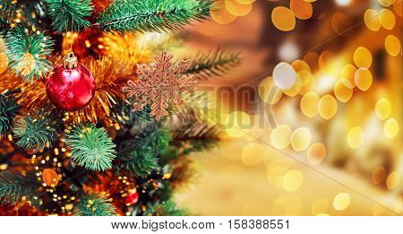Christmas tree background and Christmas decorations with blurred sparking glowing. Happy New Year and Xmas theme